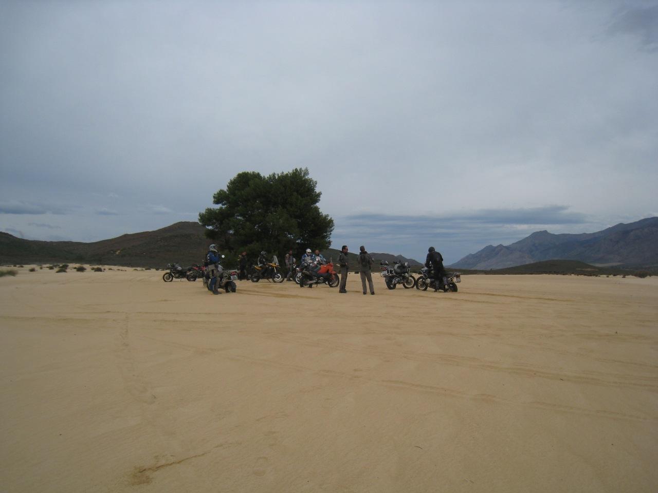 Guys in dunes taking a break