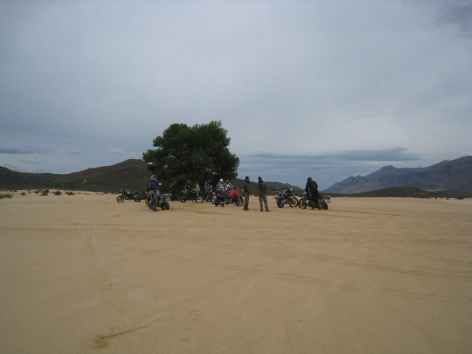 Guys in dunes taking a break