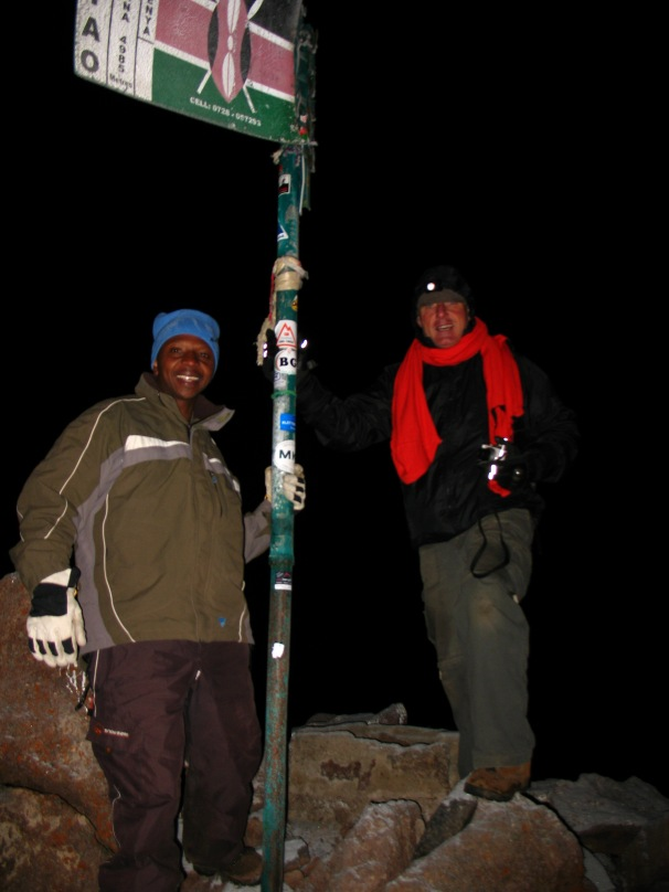 The summit of Mount Kenya ... first ones of the day (early morning) and I am bitterly cold.