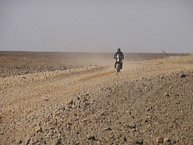 Me coming back to look for Paul and Marja who had had a puncture.  very barren and rocky stretch of road