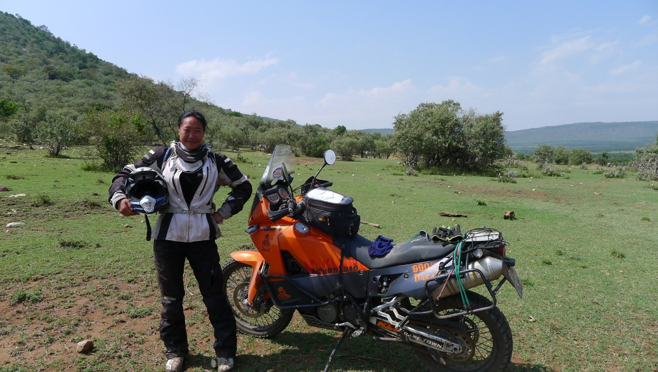 Fanny in the Masai Mara among zebras and wildebeest