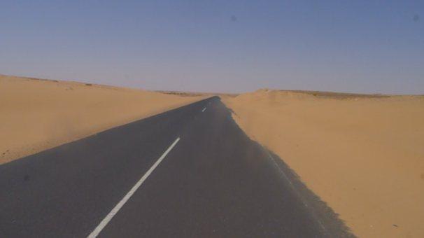 Our beautiful tar road straight through the sandy desert