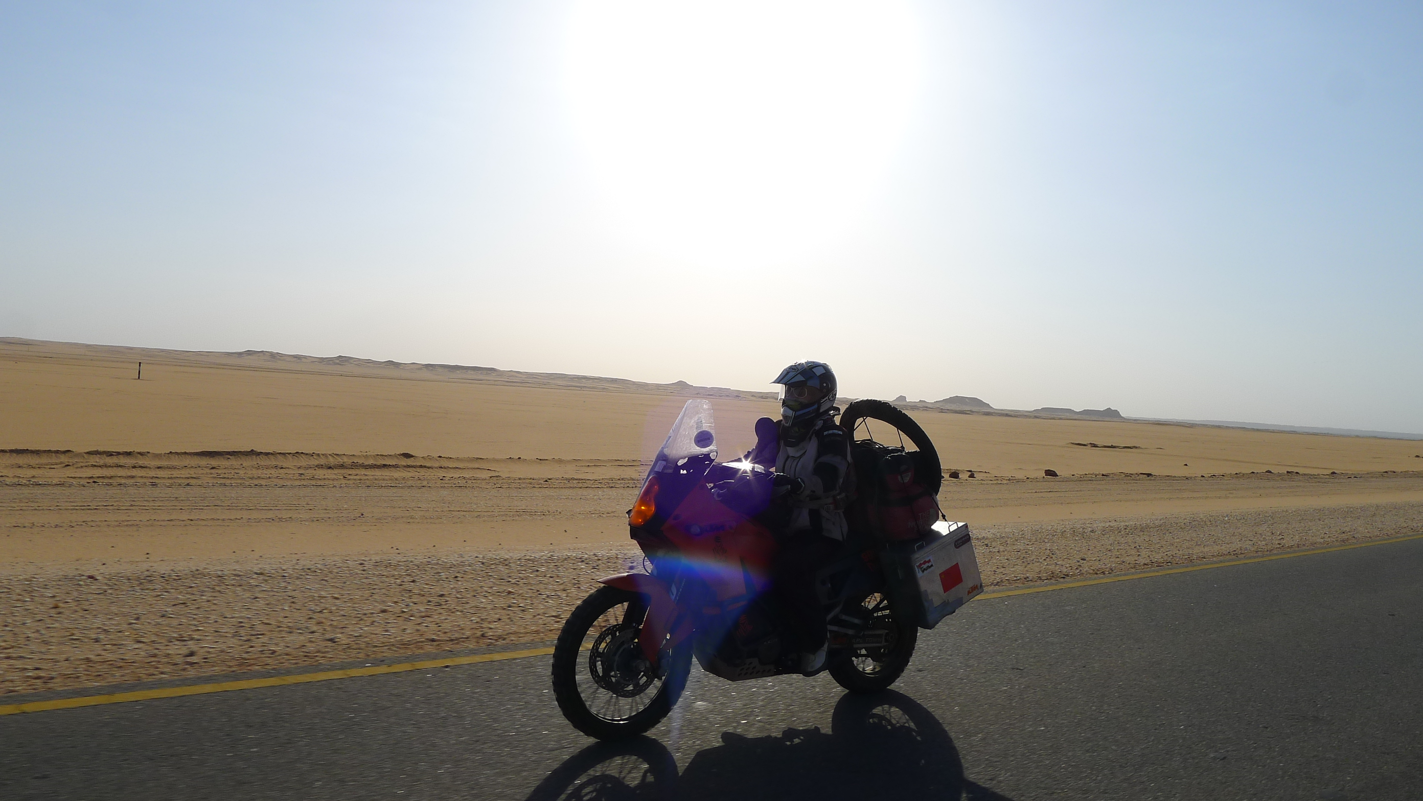 Fanny and her KTM cruising through the Nubian desert.