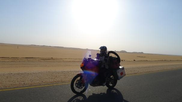 Fanny and her KTM cruising through the Nubian desert.