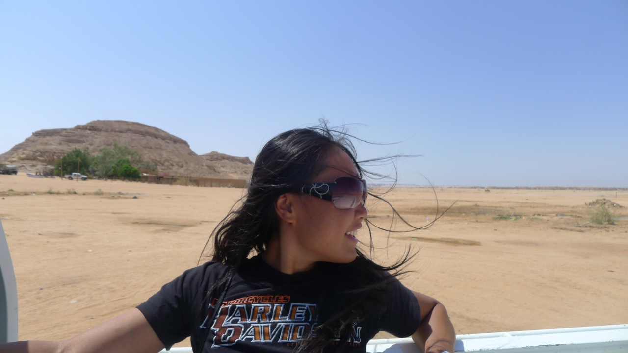 Getting a lift back to town on a pick up after getting bikes on barge at a jetty on Lake Nasser