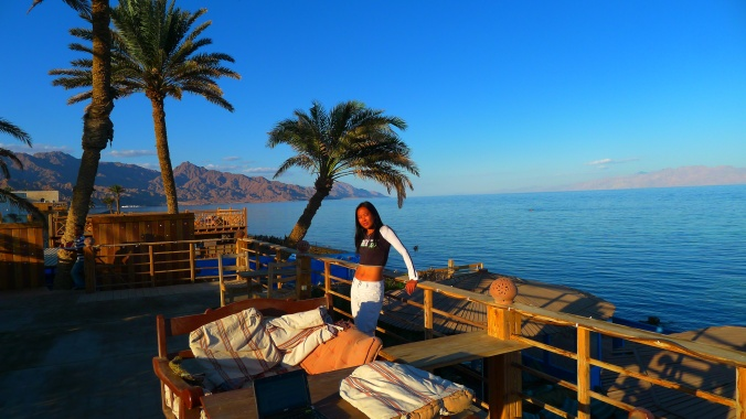 Relaxing next to the sea at one of hundreds of restaurants and coffee shops along the Dahab front