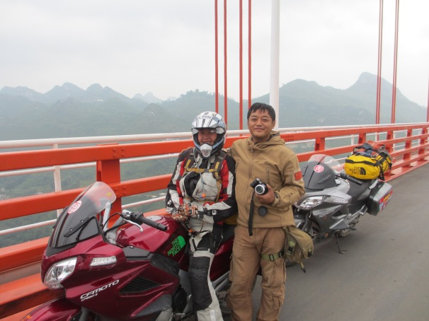 I think the only other adventure type biker we saw. On bridge high up above remote villages and valleys in Guizhou. He was riding from North east China yo Tibet.