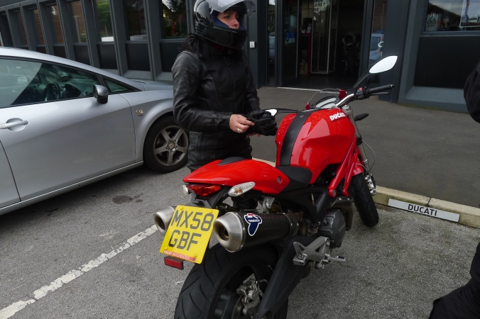 Andrea in riding kit ... and her Ducati