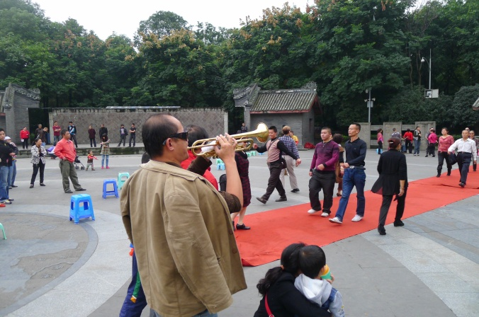 This guy was hilarious ... he played a trumpet in Chengdu People's Park while very odd people pretended to be cat walk models walking up and down a red carpet.