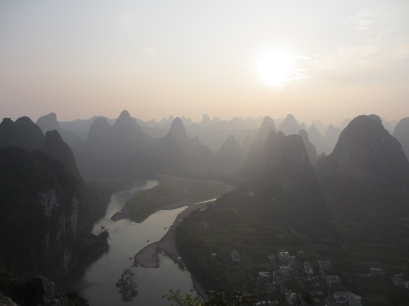 I climbed to top of one of the Karst hills (220 meters) in Xing Ping to take picture of surrounding hills along Li Jiang river towards Yang Shuo.