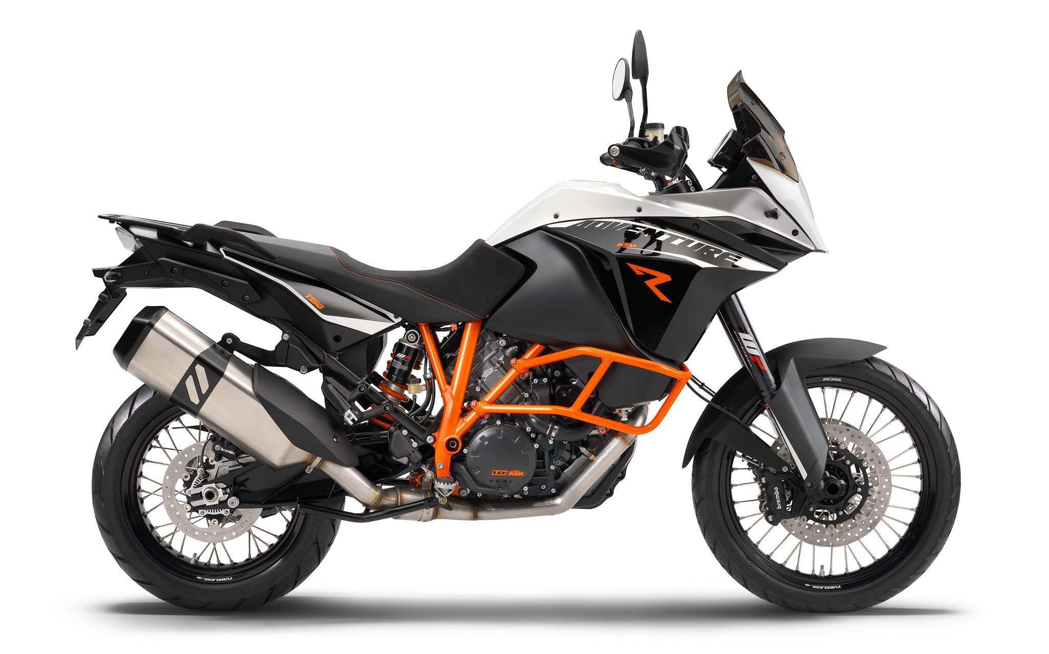 BEHOLD! the new KTM 1190 Adventure ... with tubeless tyres.  An ugly exhaust because of the  EU emission regulations, but nothing Akropovik can't sort out.