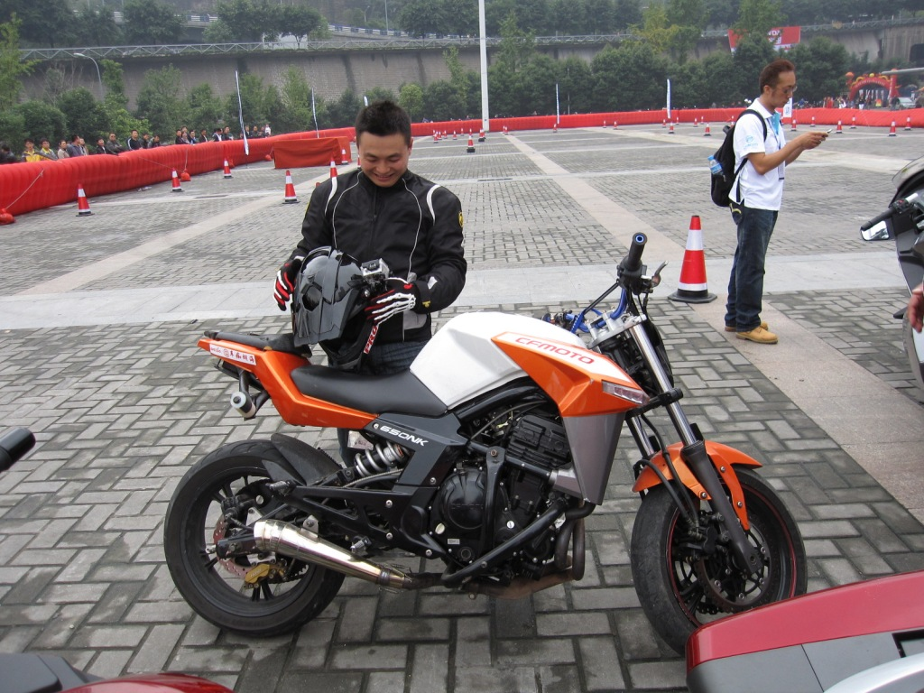 CF Moto's stunt rider -- Hu Hai  ( or as I call him Hu Li  Gan) ... I have seen many stunt riders and none as passionate, fun and skillful as Hu. Great guy.