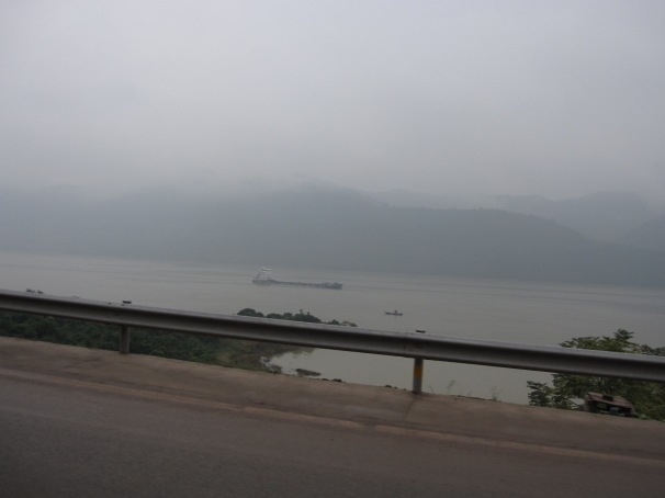 Riding eastwards from Fengdu along a very misty Yangtze River