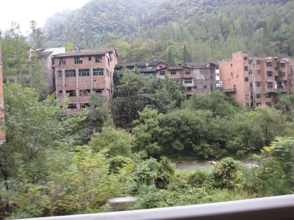 Forget at Fengdu, this is the real ghost town in Chongqing. We rode past it in the middle of the forest and it seemed completely deserted.