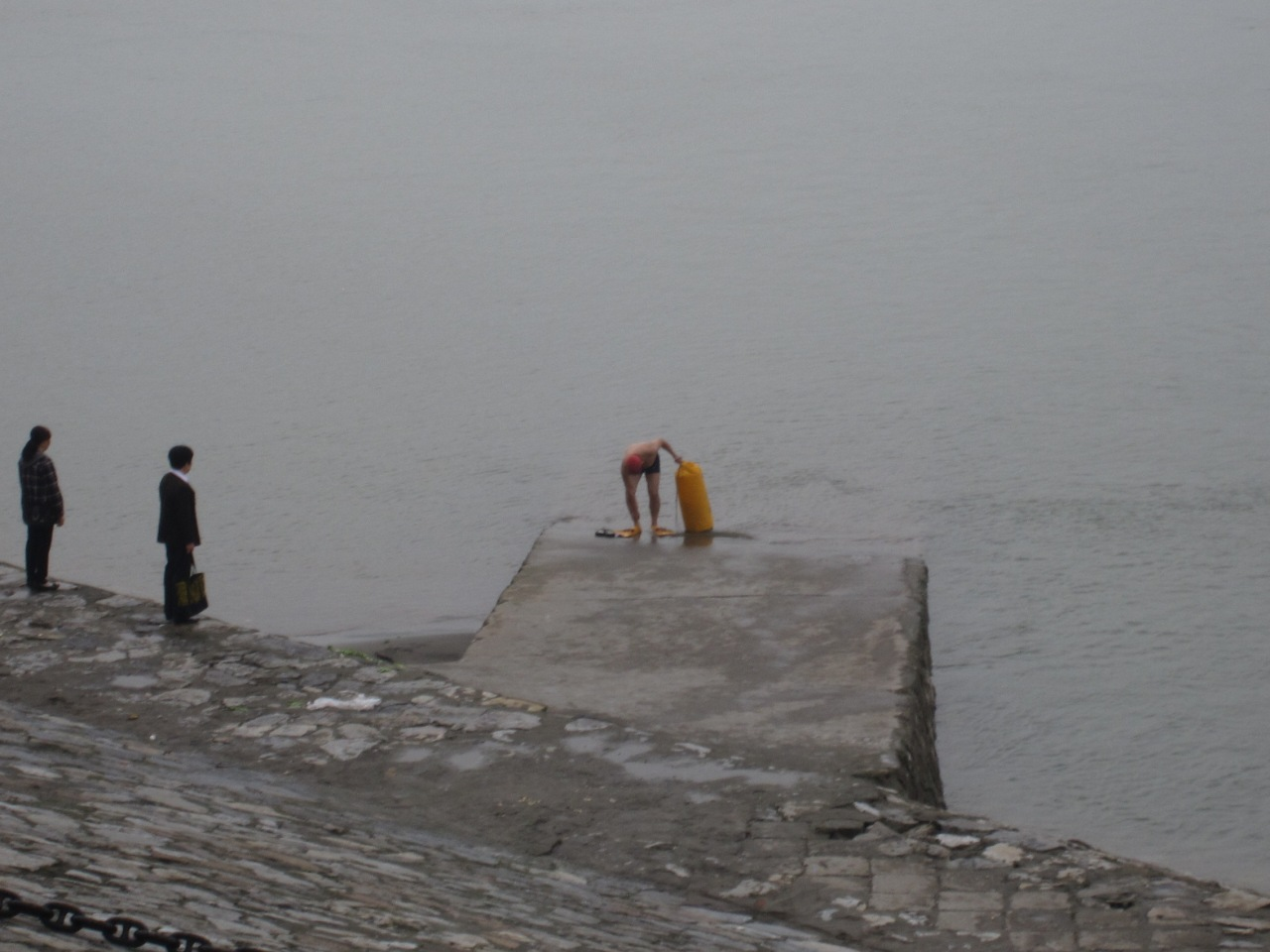 Local guys attaching themselves to buoys and floating across river