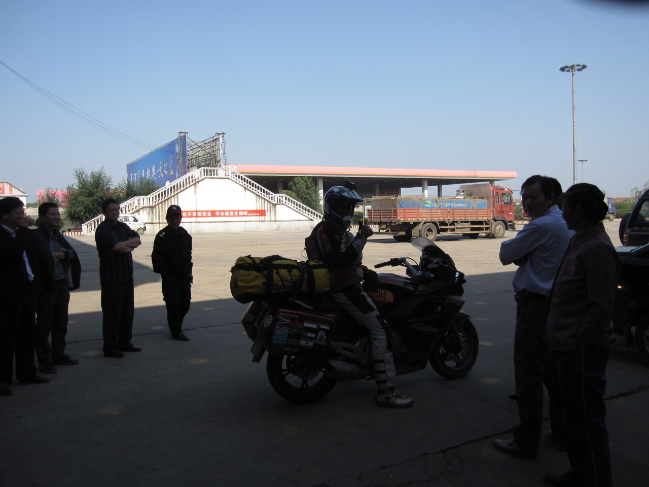 Where ever we stop, large crowds come up to see the bikes. A rare sight  I guess to many people in China.