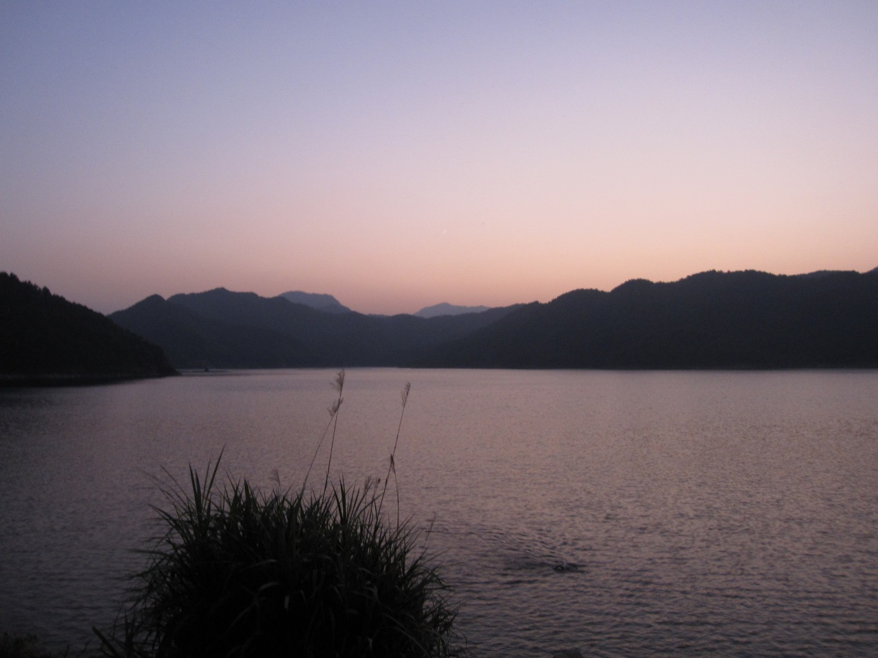 Swimming in Huating lake as the sun sets