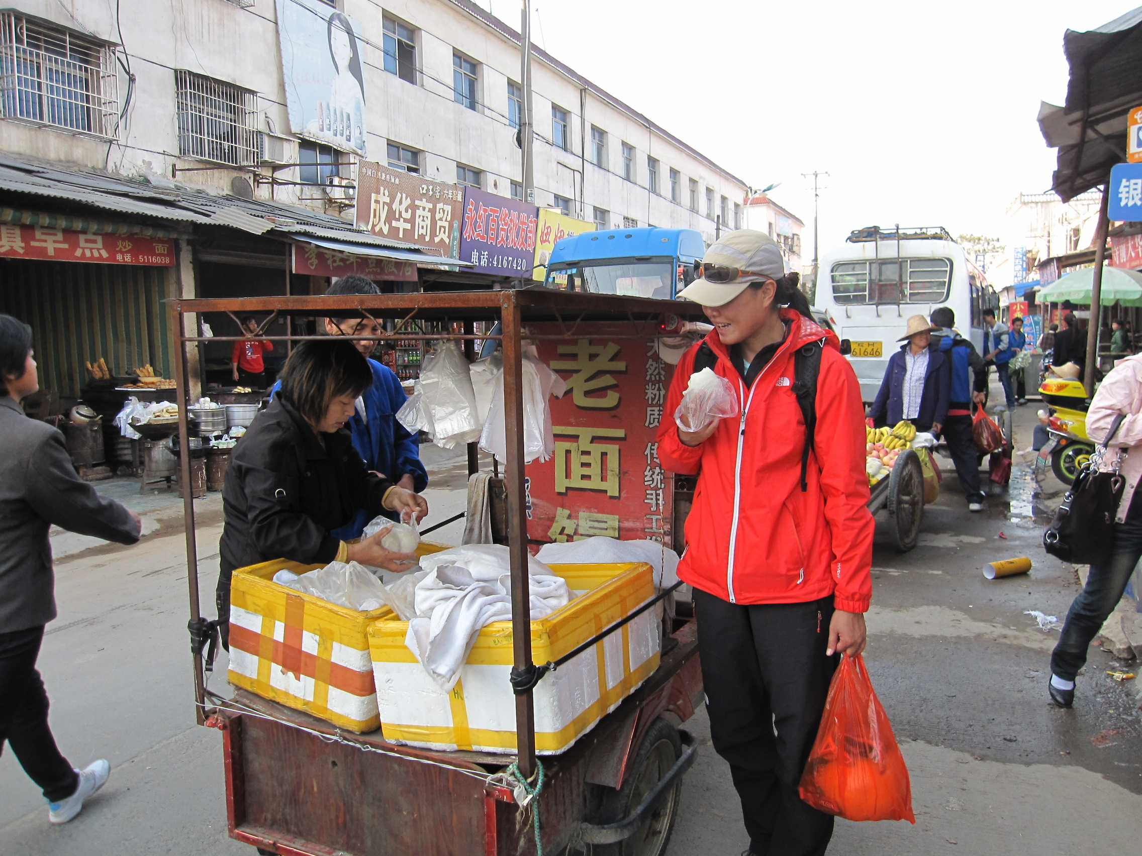 "Fanny eating ""mantou"" (a kind a bread bun) from a hawker in the main town"