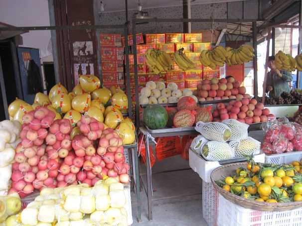 Local fruit stall... selling You Zi (Pomelo) which we eat often