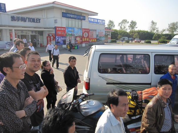 Our last petrol stop ... as always in China draws a crowd.